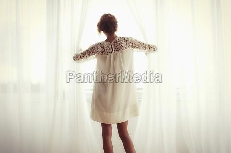 woman window porthole dormer window pane
