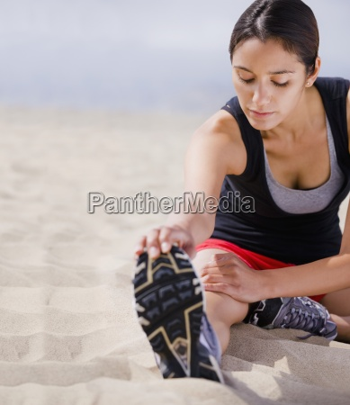 young girl stretching after a run