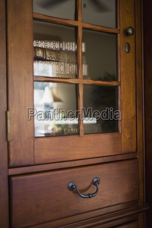 detail wooden cabinet with books