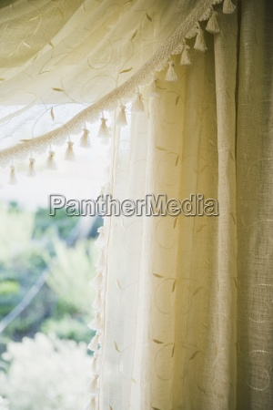 detail embroidered curtains with tassels