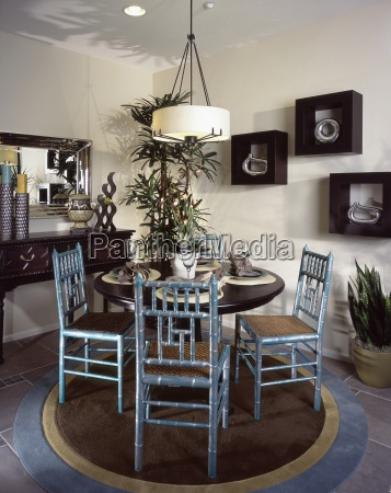 arranged dining table and chairs in