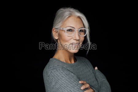 portrait of smiling woman wearing glasses