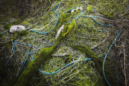 heaped up fishing nets with floats
