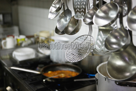 close up of spoons in restaurant