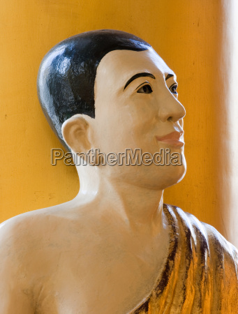 statue at the shwedagon pagoda myanmar