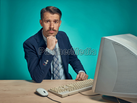 sad young man working on computer