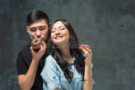 young asian couple enjoy eating of
