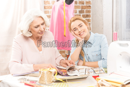 two smiling seamstresses