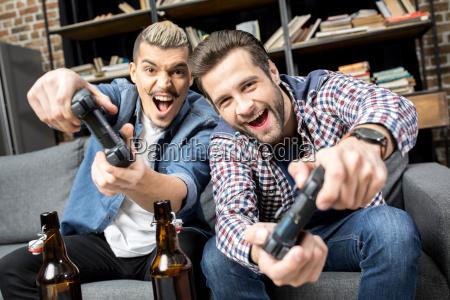 men playing with joysticks
