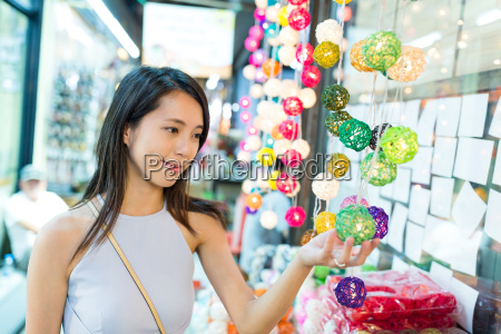 woman shopping at weekend market of
