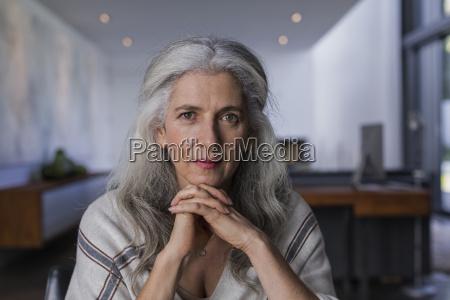 portrait confident serious mature woman with
