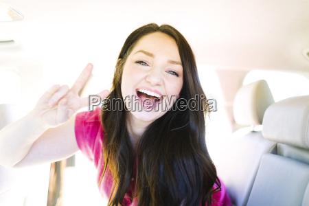 woman making peace gesture
