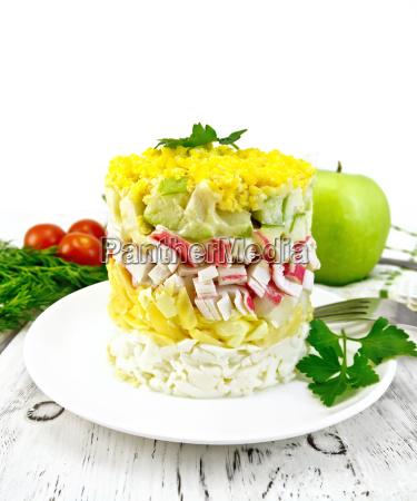 salad of crab sticks on light